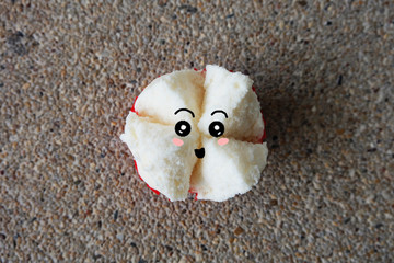 Thai Dessert, White Chinese New Year Steamed Cup Cake Scared Face on Concrete Background Great For Any Use.