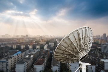 In the city night background large satellite antenna