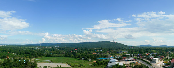 MUKDAHAN, THAILAND - AUGUST 8, 2017: Mukdahan cityscape view that can see big Buddha statue on the mountain.
