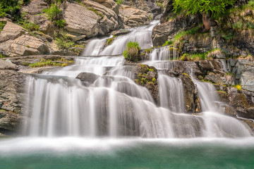 Tuinposter Watervallen Lillaz waterfalls near Cogne, Gran Paradiso national park, Aosta Valley in the Alps, Italy