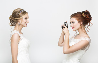 Two young pretty brides making wedding photo