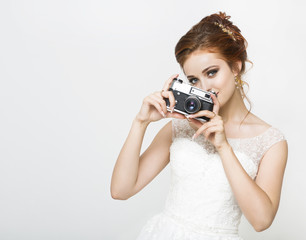Young pretty bride with photo camera