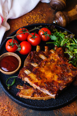Grilled pork ribs with vegetables. Copy space