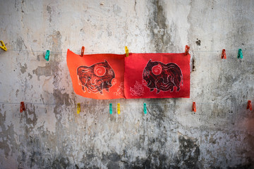 Dong Ho paintings on old aged wall. Dong Ho folk woodcut ancient painting, an aesthetic symbol in Vietnam culture
