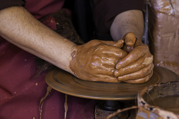 Hands of a potter forming clay