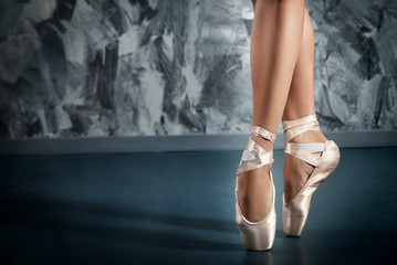 Ballerina in pointe shoes. Ballet posing, performance