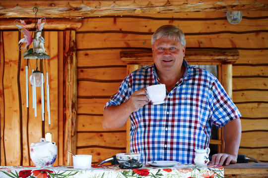 "Gary Blackburn, a 53-year-old tree surgeon from Lincolnshire, Britain, is having tea time with typical British short bread at his British curiosities collection called ""Little Britain"" in Linz-Kretzhaus"
