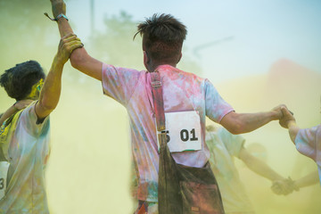 People dancing at an color run event