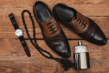 classic men's accessories on the brown table. stylish men's accessories on the wooden background.