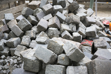bunch of cobbel stones on a construction site