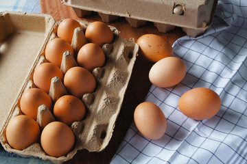fresh and organic eggs from organic egg farm, healthy food product in paper box container.