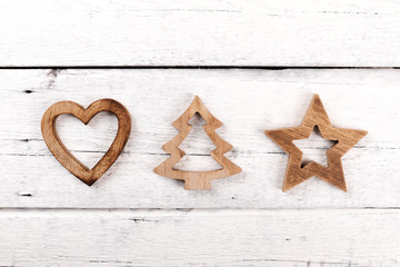 christmas greeting card - wooden decorations on white wood background