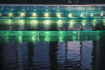Green lights in a fountain at night as abstract background
