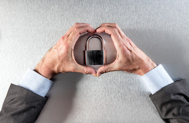 protecting businessman hands in love with data security core symbol