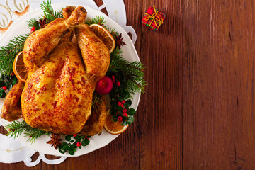 Roasted whole chicken with Christmas decoration.
