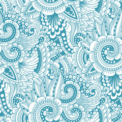 Seamless ornamental  ethnic doodle pattern. Floral background with flowers, berries, waves, leaves, curly lines. Good for wallpaper, pattern fills, textile, fabric, wrapping, surface textures.