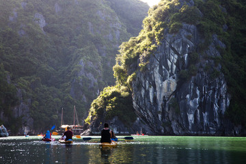 kayaking among caves and lagoon in Ha Long bay, UNESCO world heritage site, Vietnam
