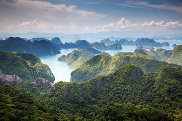 scenic view over Ha Long bay from Cat Ba island, Ha Long city in the background, UNESCO world heritage site, Vietnam