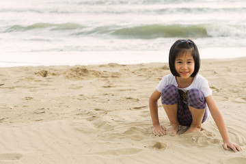 child 6s girl enjoy play beach sea