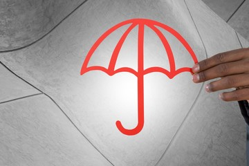 Composite image of hand holding a red umbrella