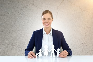 Composite image of family in white paper with a woman in the