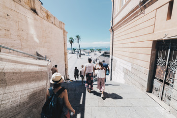 Tourists walking in the capital of Sardinia