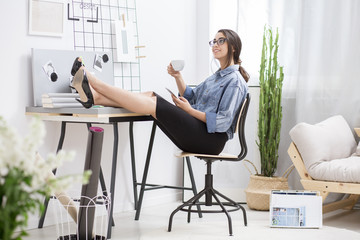 Satisfied businesswoman resting at home