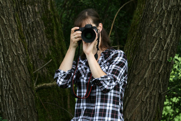 Happy smiling influencer photographer taking pictures for social media