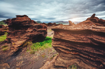 Sandy rocks formed by winds. Location Sudurland, cape Dyrholaey, Iceland, Europe.
