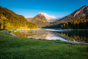 Great view of the azure pond Obersee glowing by sunlight. Location Nafels, Swiss alps, Europe.