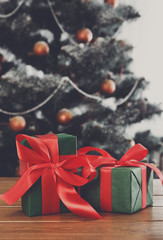 Christmas presents on decorated tree background, holiday concept