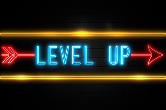 Level Up  - fluorescent Neon Sign on brickwall Front view