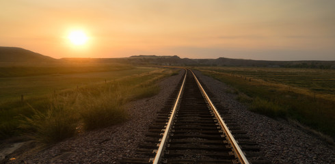 Railroad Tracks Reflect Sunrise Rural American Transportation Landscape