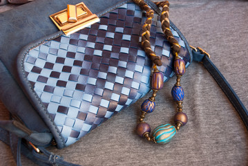 Bohemian jewelry necklace indian with small woman bag. Handmade beads inoriental style of polymer clay.