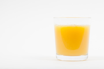 Glass of isolated fresh orange juice