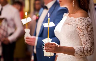 newlyweds exchange rings, wedding rings on a wedding ceremony in the church,wedding ceremony, glans