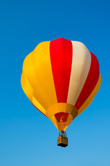 Foto op Aluminium Luchtsport Colorful of Hot air balloon with fire and blue sky background