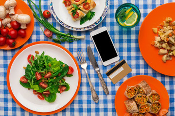 Healthy food shopping online with credit card, top view, copy space