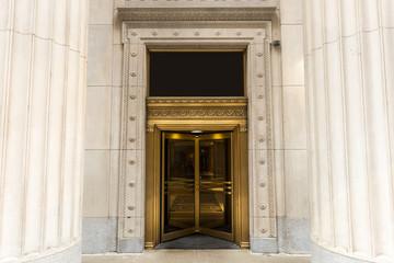 Golden revolving door with massive columns