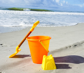 A Shovel and Pail on the Beach in the Sand