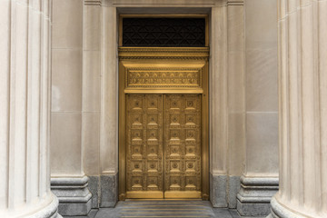 Decorative golden door with solid columns
