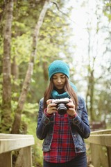 Woman looking clicked photos in vintage camera