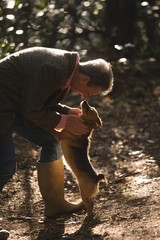 Man with his pet dog in forest