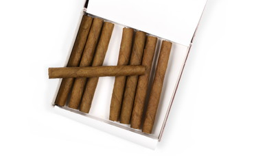 Cigarillos without filter in box isolated over white background, top view