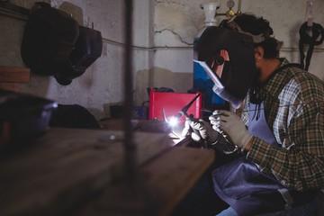 Wielder working in workshop