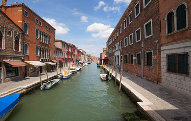 Murano Island, small village near the Venice / Panorama of the river canal and historical architecture
