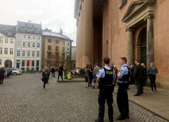 Danish police officers guard next to the court building in Copenhagen