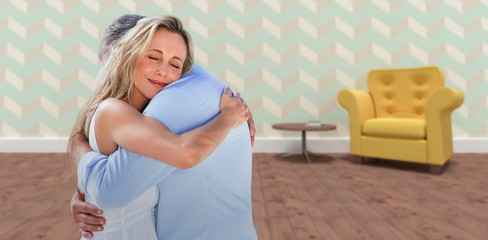 Composite image of mature couple embracing