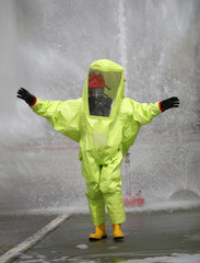 yellow protective suit with air filtering system to breathe duri