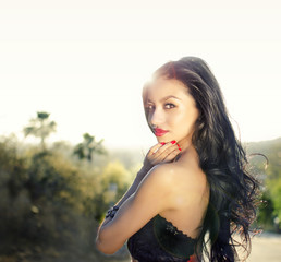 Beautiful woman with long dark curly hair
